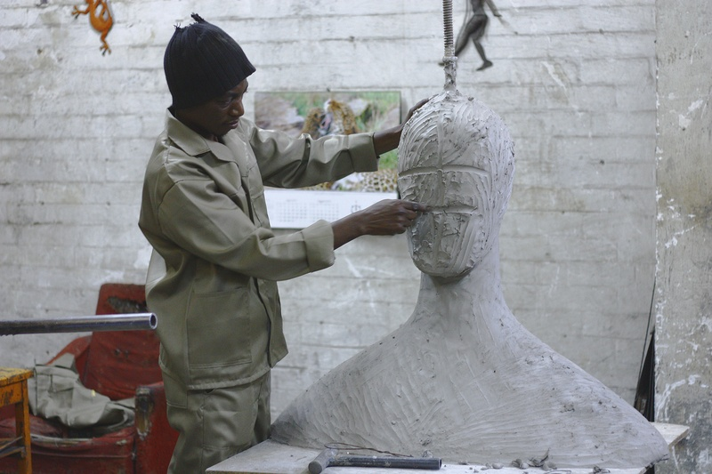 A Sculptor Works in His Studio Sculpting A Large White Body