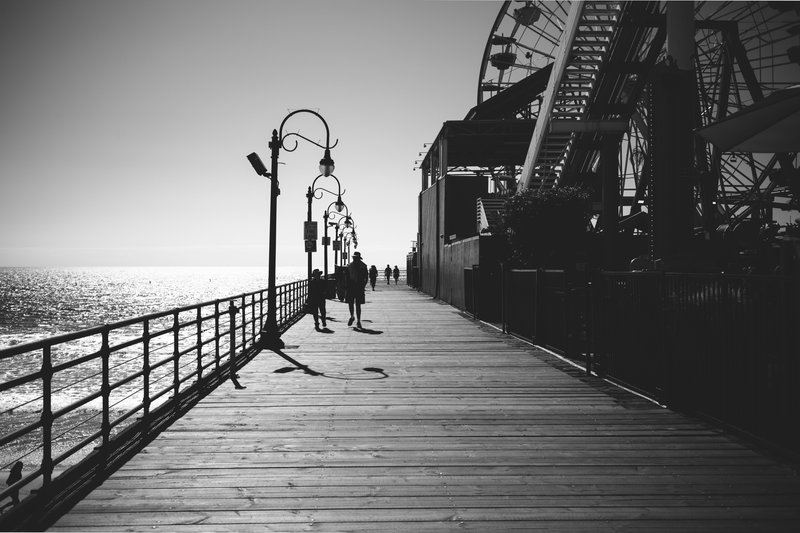 Black And White Image Walking Along The Boardwalk