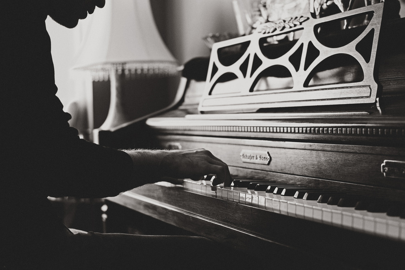 Black & White  Man Playing Spinet Piano Close-Up