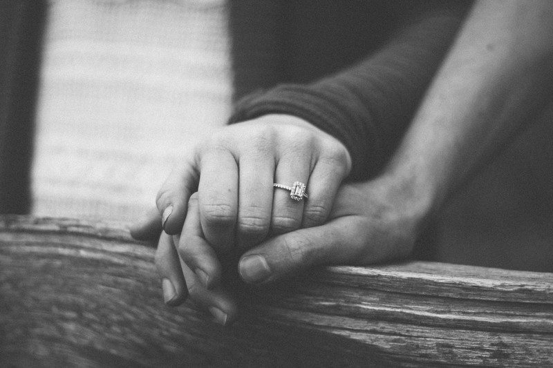 Black & White Photography of Couple Holding Hands