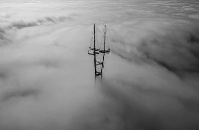 Black & White  Tower Surrounded By Clouds