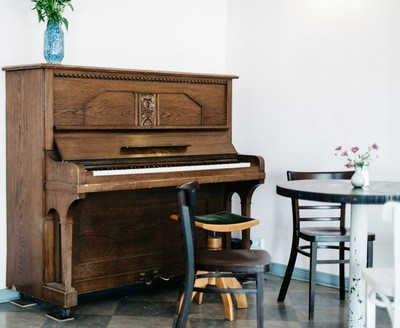 Brown Piano in Front of White Wall