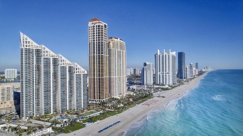 Buildings, Beaches, and Blue Sea Water