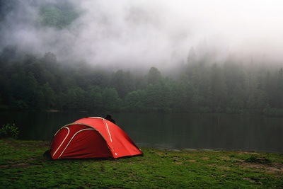 Camping by Foggy Forest in Red Tent