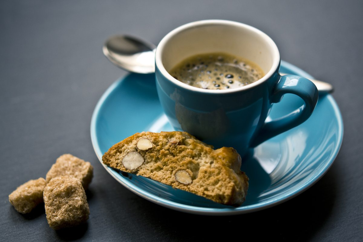 Cup of COffee And Bread on Saucer Closeup