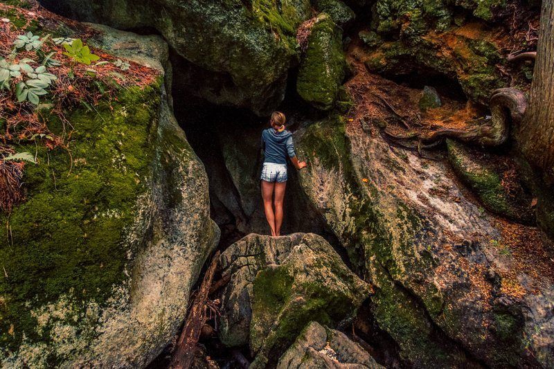 Exploring The Mouth Of A Mossy Cave