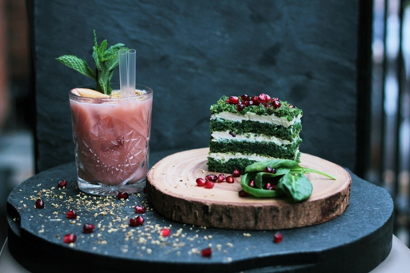 Green And White Cake Slide on Brown Wooden Plate