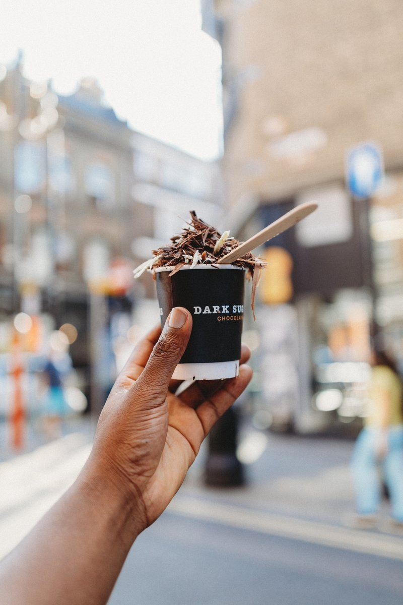 Hand Holding Cup Of Chocolatey Delicious