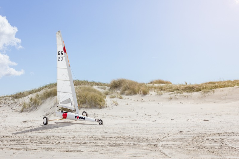 Landscape  White Sailboat with Wheels on Sand