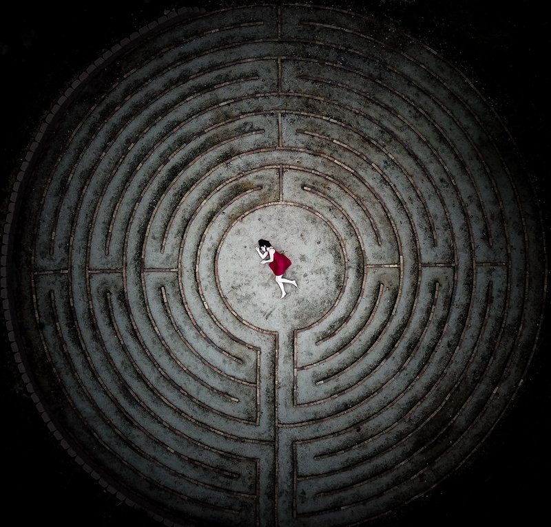 Laying Down At The Center Of A Maze