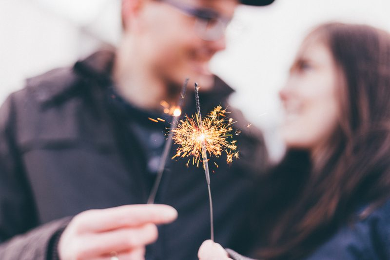 Man And Woman Holding Fireworks