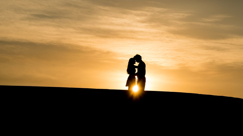 Man And Woman's Silhouette on Hill