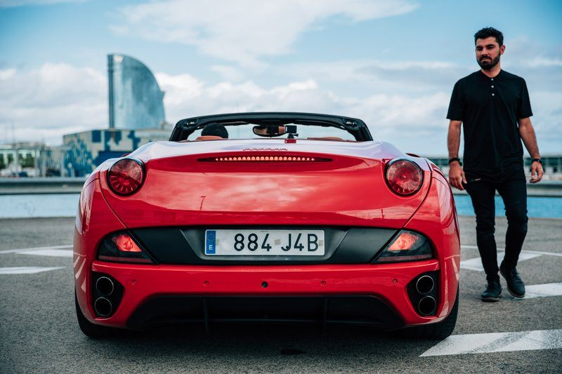 Man Beside Euro Sports Car