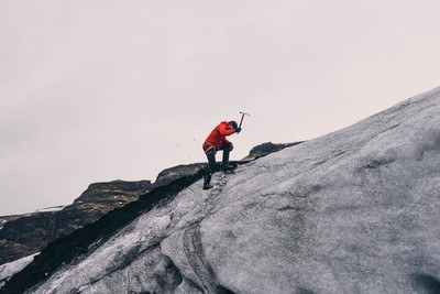 Man Climbing on Mountain