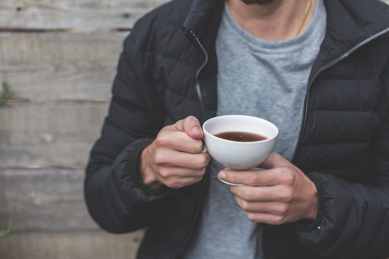 Man Holding Cup Of Tea