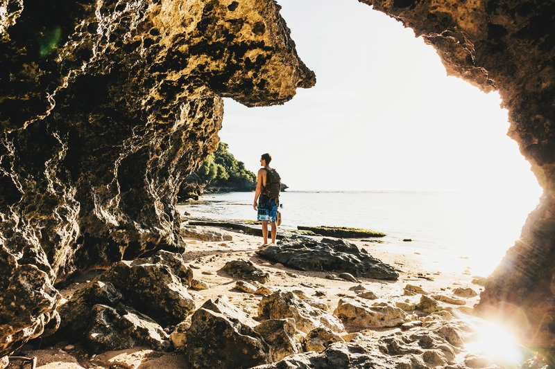 Man on Cave Beach