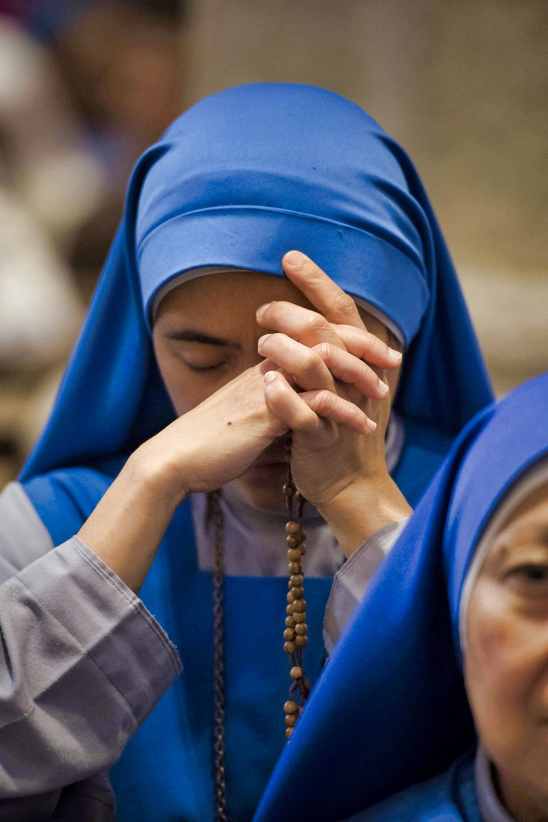 Nun praying the Rosary
