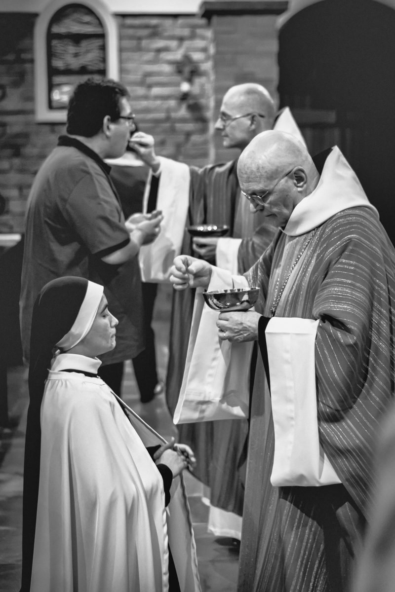 Nun receiving communion