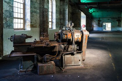 Orange Lathe Machine in Empty Room