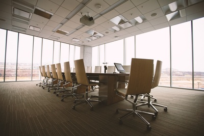 Oval Brown Wooden Conference Table And Chairs inside Conference Room