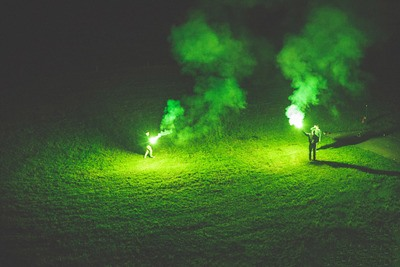 People Holding Flares