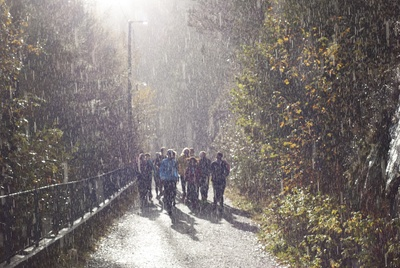People in Pathway During Rain