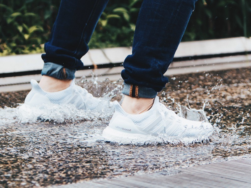 Person Wearing Pair of Gray Adidas Ultraboost Low-Top Sneakers Stepped on