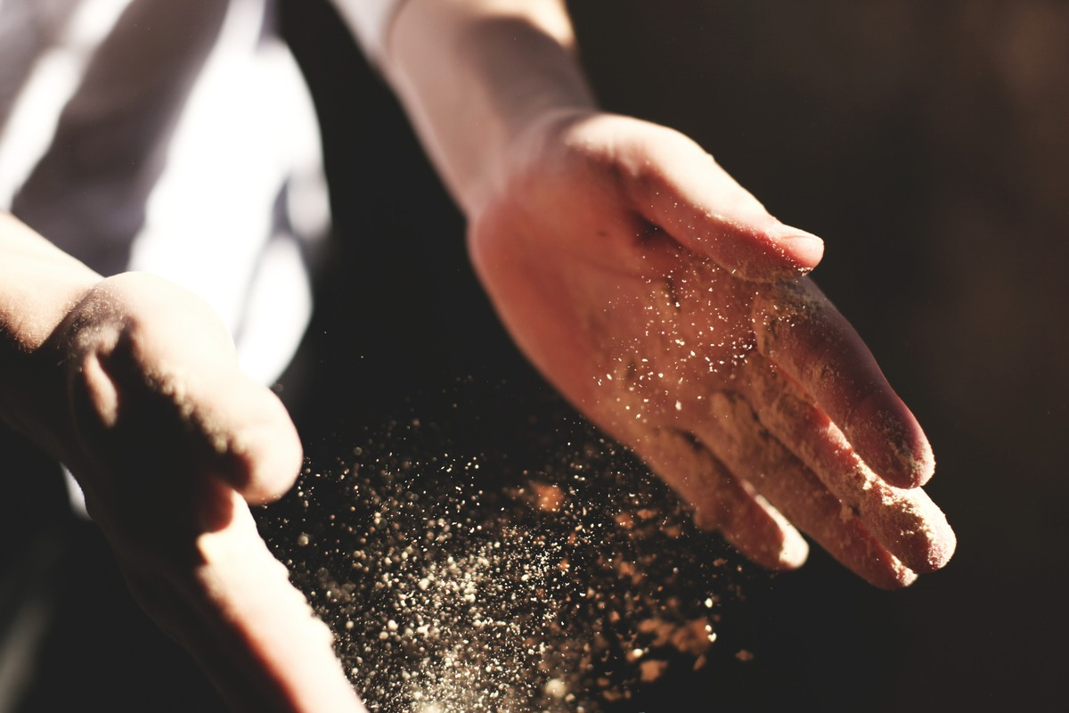 Person's Hand with Dust