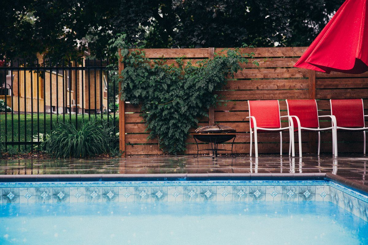 Rain Falls On Clean Pool And Deck