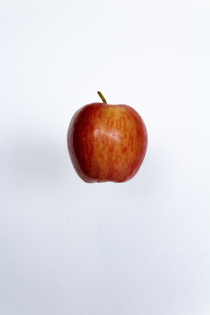 Red Apple Against White Background