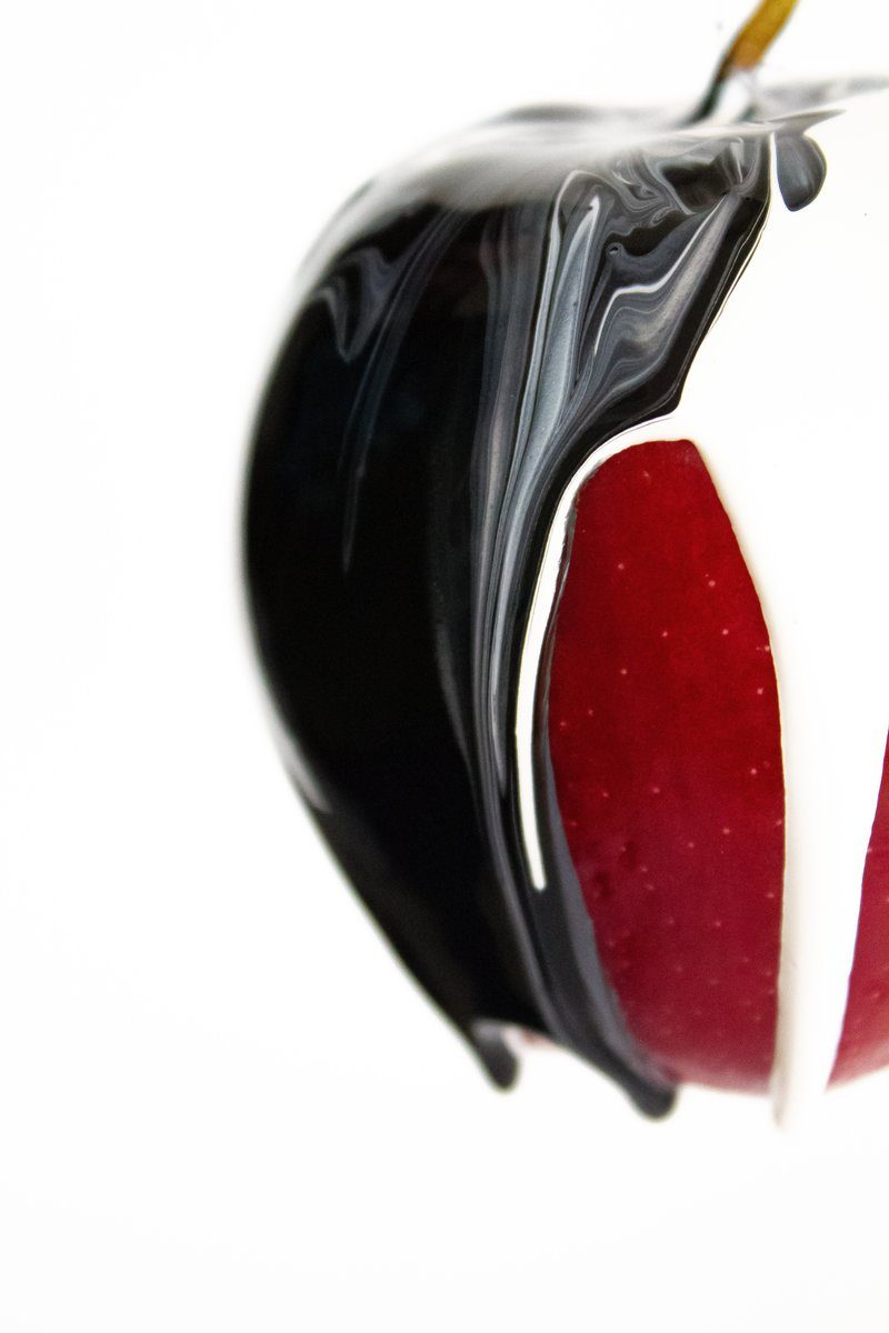 Red Apple With Black And White Paint
