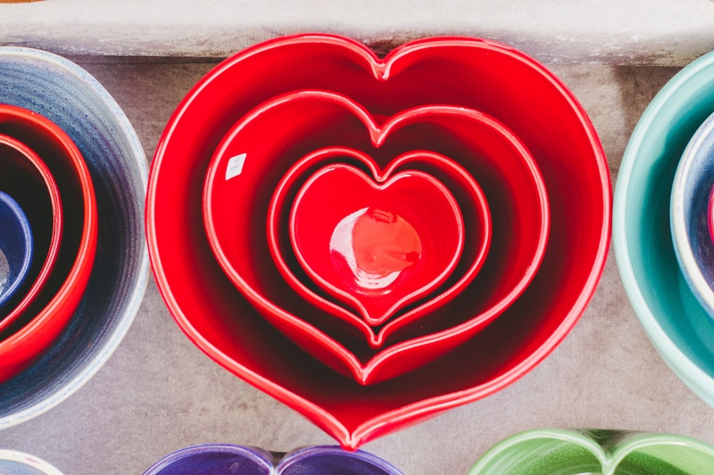 Red Heart-Shaped Ceramic Bowls of Different Sizes Stacked one inside the