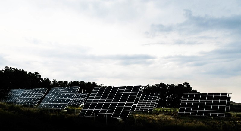 Silhouette Photography of Assorted Solar Panel Behind Trees