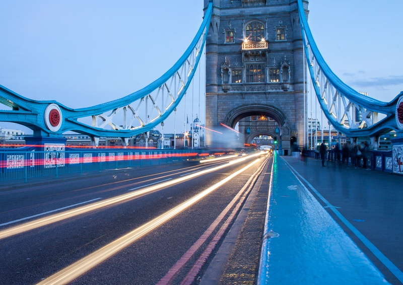 Time-Lapse Photography of Cars Passing Through Bridge