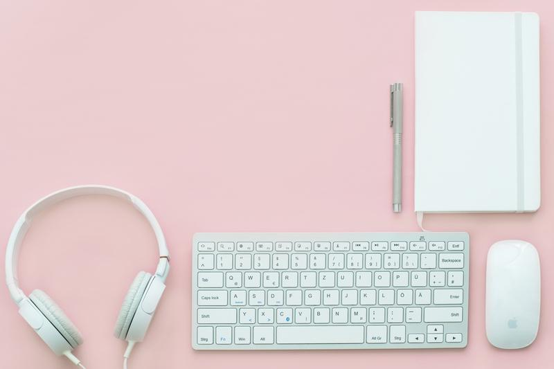 White Apple Magic Mouse Beside of Magic Keyboard And Headphones