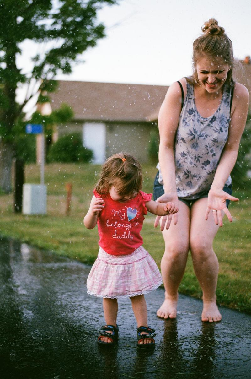 Woman And Girl Play With Water