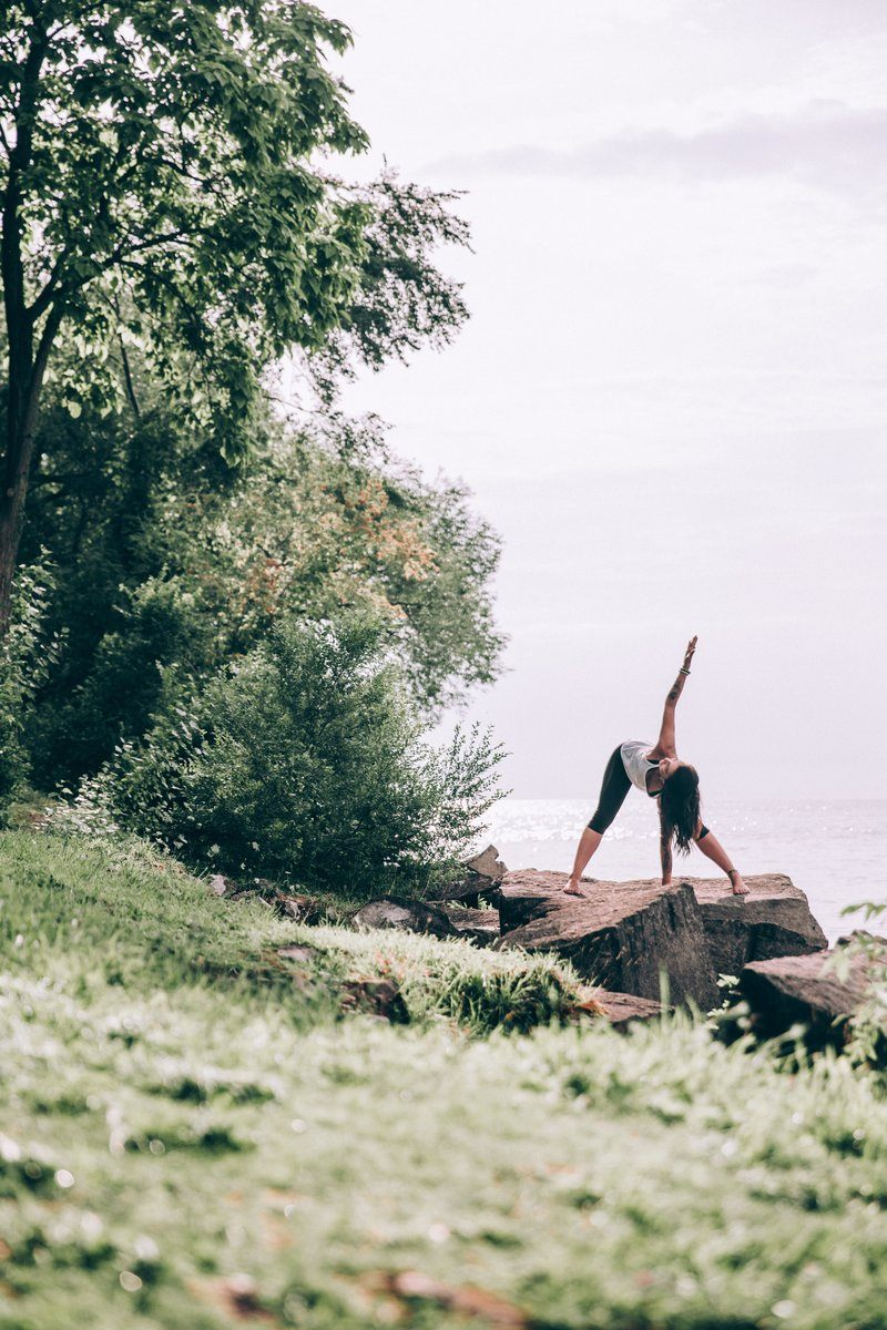 Woman Does Yoga Outdoors