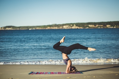 Woman Doing Yoga Beside the Seashore