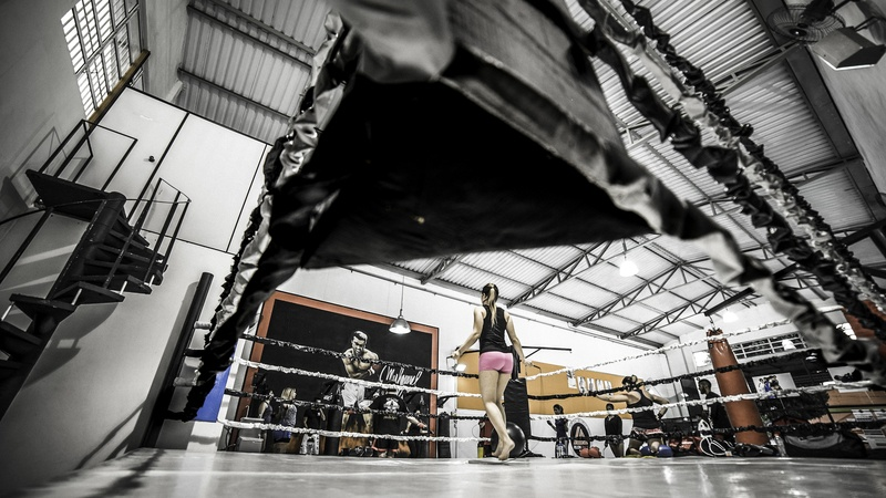 Woman Standing on Boxing Ring
