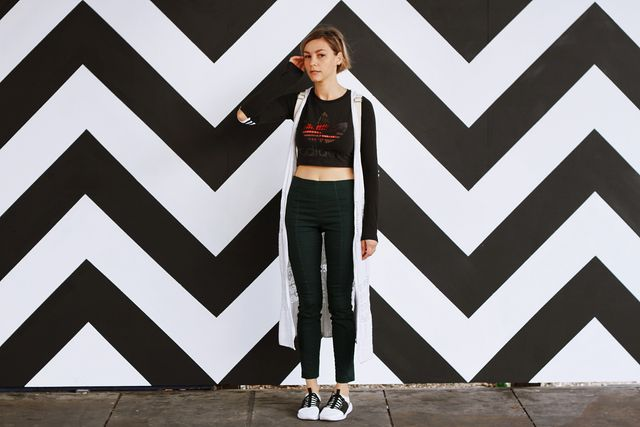 Woman by Patterned Wall